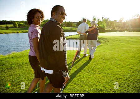 Friends Playing Golf, Burlington, Ontario, Canada - Stock Photo
