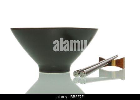 Asia bowl beside chopsticks - Stock Photo