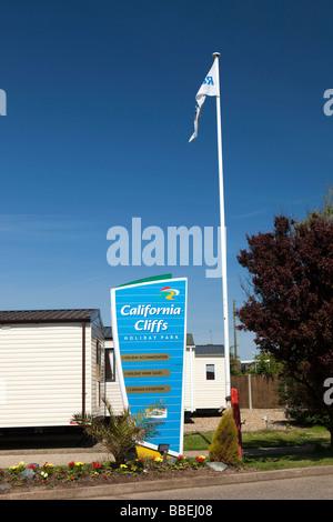 UK England Norfolk California Cliffs Caravan Park sign - Stock Photo