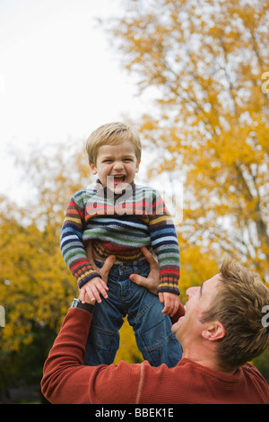 Father Lifting Son Up in the Air, Portland, Oregon, USA - Stock Photo