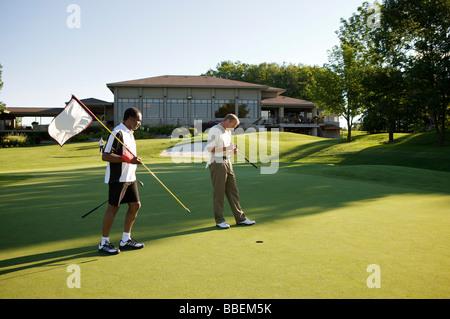 Men Golfing, Burlington, Ontario, Canada - Stock Photo