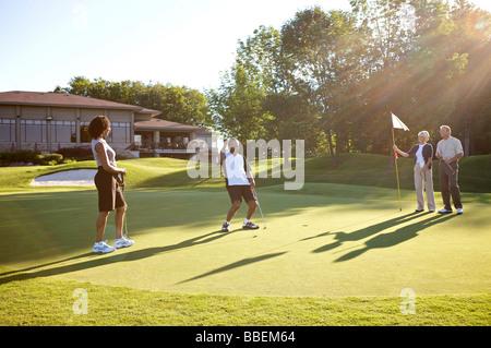 Couples Golfing, Burlington, Ontario, Canada - Stock Photo