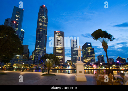 Skyline of Singapur Raffles Statue South East Asia twilight Singapore - Stock Photo