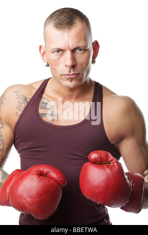 muscular young man in boxing gloves ready to fight - Stock Photo