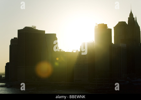 Silhouette of city skyline at sunset - Stock Photo