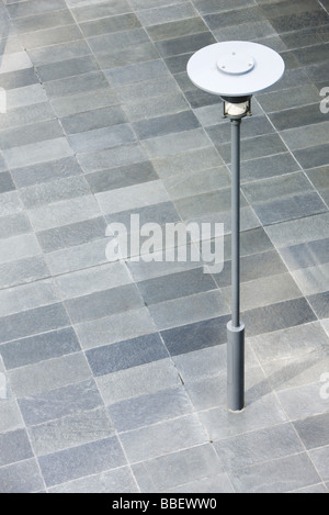 Lamp post in city square - Stock Photo