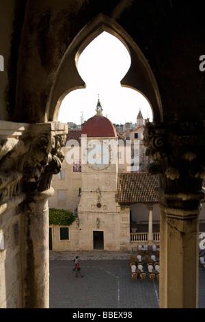 View to Town Clock Tower in Square John Paul II from Cathedral of St Lawrence Trogir Dalmatian Coast Croatia Dalmatia - Stock Photo