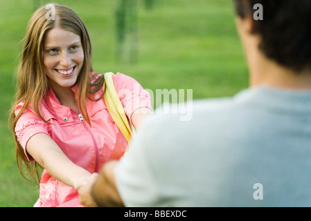 Young couple face to face, holding hands, cropped view - Stock Photo