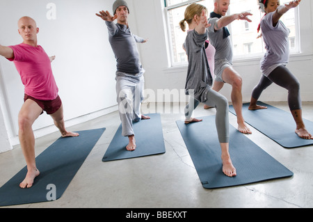 Students and instructor in yoga class, Vancouver, British Columbia - Stock Photo