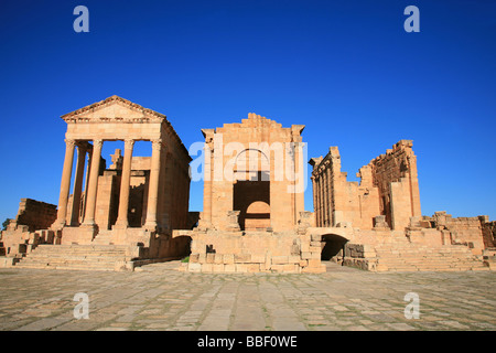 The temples of Minerva, Jupiter and Juno at the Grand Forum in Sbeitla, Tunisia - Stock Photo