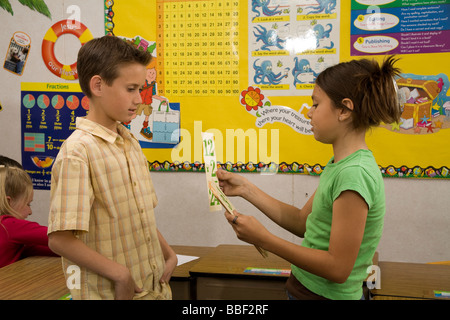 Two young Children 8-9 year years old studying math flash cards wall decor posters classroom US USA United States - Stock Photo