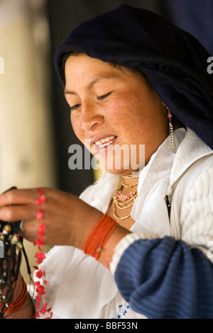 Indigenous woman with her beadwork - Cotacachi - Imbabura Province, Ecuador - Stock Photo