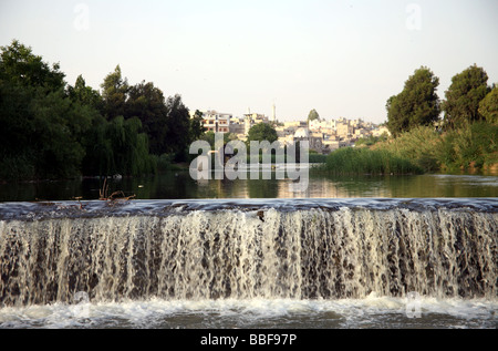 Syria Hama waterwheels, noria on the Orontes river - Stock Photo