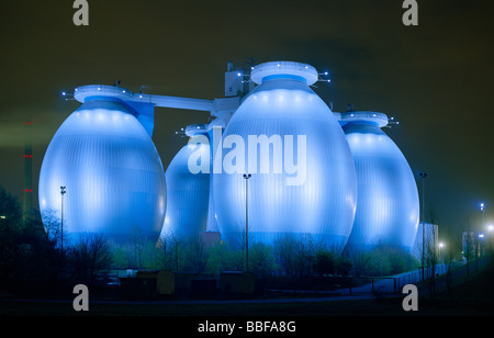 digestion towers of the clarification plant in Bottrop Ruhr Area floodlited at night Faultürme des Bottroper Klärwerk - Stock Photo