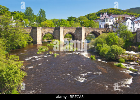 Famous River Dee Bridge built by Bishop Trevor in 1345 Llangollen Denbighshire North Wales Cymru UK United Kingdom - Stock Photo