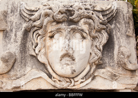 Ancient stone sculpture of the Medusa at the ruins of the Temple of Apollo at Didyma in Turkey - Stock Photo