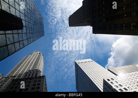 Chrysler building and other skyscrapers in spring sun sunshine blue sky midtown Manhattan New York City USA - Stock Photo