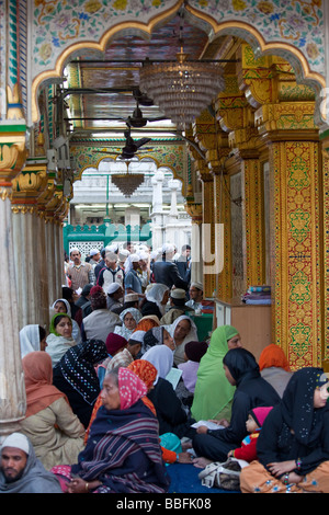 Muslim Women Praying at Hazrat Nizamuddin Shrine in Delhi India - Stock Photo