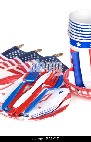 July fourth patriotic utensils including plastic forks knives spoons napkins plates and cups on a white background - Stock Photo