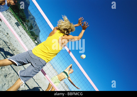 Male preparing to block volleyball - Stock Photo