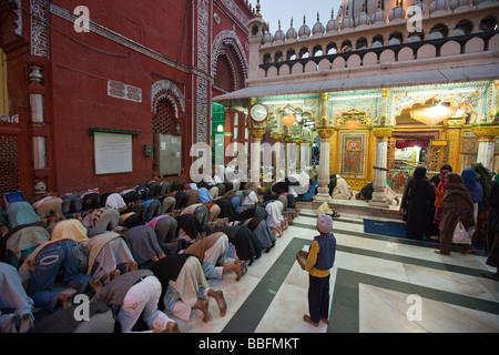 Muslim Prayer at Hazrat Nizamuddin Shrine in Delhi India - Stock Photo