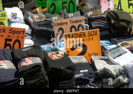 sock socks foot wear feet lost losing a price tag market stall cheap clothes clothing - Stock Photo