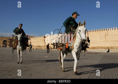 Africa, North Africa, Morocco, Fes, Fès el Bali, Old Fes, Medina, Bab el Mahrouk, Old Town, Men Riding Horses - Stock Photo