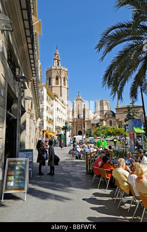 Street café, people, Plaza de la Reina Square, Catedral de Santa Maria Cathedral, Miguelete tower, Valencia, Spain, - Stock Photo