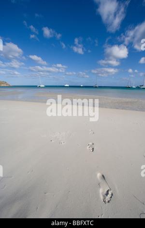 Footprints on sand beach. - Stock Photo