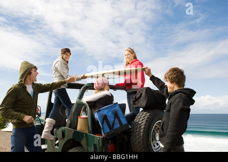 Surfer friends at the coast - Stock Photo
