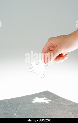 Person with jigsaw piece - Stock Photo