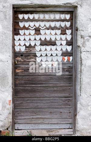 Old stable door with milk certificates, milk seals of quality, North Tyrol, Austria, Europe - Stock Photo