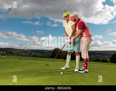Mature ladies learning to playing golf - Stock Photo