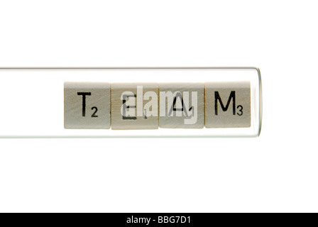 Lettering 'Team' in a test tube - Stock Photo