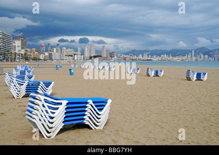 Empty beach, deck chairs, dark clouds, bad weather, crisis, Playa de Poniente, Ponent, beach, Benidorm, Costa Blanca, - Stock Photo