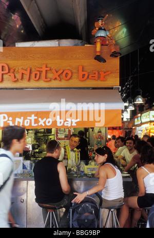 Pinotxo tapas bar in La Boqueria St Josep Market on La Rambla Barcelona Catalonia Spain - Stock Photo