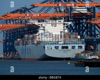 Large Cosco container ship at Euromax terminal in the port of Rotterdam Zuid Holland the Netherlands - Stock Photo