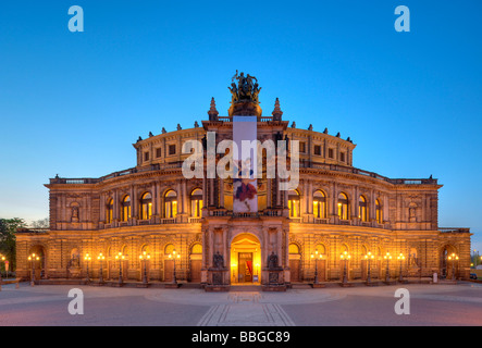 Night shot, illuminated Semperoper opera house with flags, Theaterplatz square, Dresden, Free State of Saxony, Germany, - Stock Photo