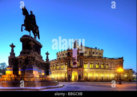 Night shot, illuminated Semperoper opera house with flags and King John statue, Theaterplatz square, Dresden, Free - Stock Photo