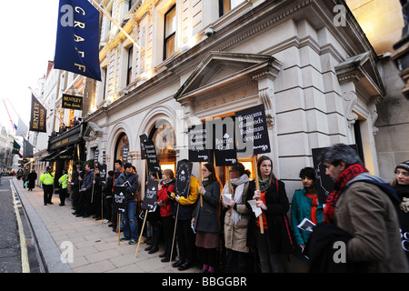 Survival International staging a protest outside the Graff shop in London's New Bond Street. - Stock Photo