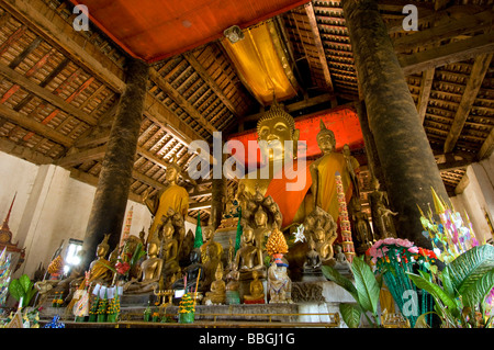 temple with Buddha statues, Laos, Luang Prabang - Stock Photo