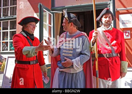 actors dressed in historic costumes at Schnoorviertel, Bremen, Northern Germany - Stock Photo