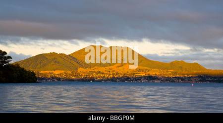 Evening light on Mountains Behind Taupo viewed from Acacia Bay North Island New Zealand - Stock Photo