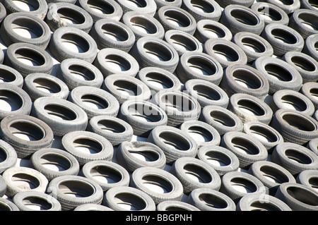 Lots of old tires dumped in a landfill - Stock Photo