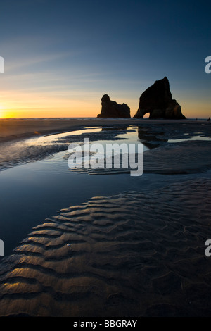 Rippled Sand and rock formations at Wharariki Beach Nelson South Island New Zealand - Stock Photo