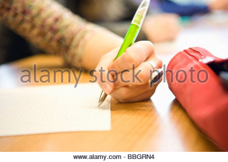 Close-up hand writing with pen - Stock Photo