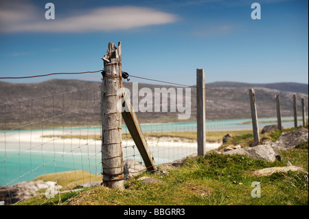 Old Wooden fence post on coastal cliffs, Isle of Harris, Outer Hebrides, Scotland - Stock Photo