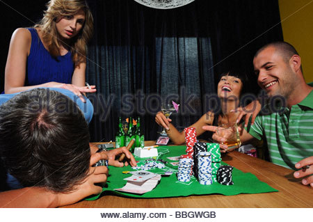 Group young adults playing poker - Stock Photo