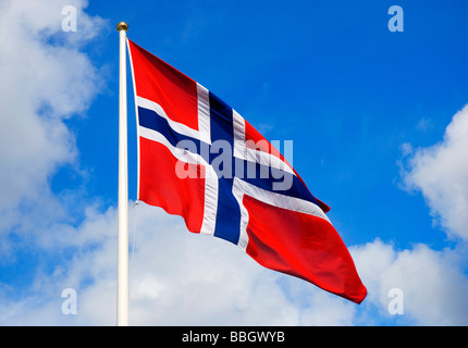 Norwegian flag floating in the wind during Norwegian national day celebrations in the beautiful town Bergen. (May - Stock Photo