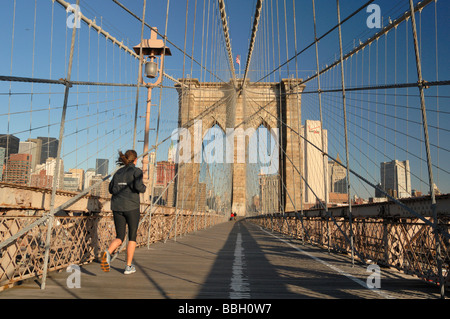 Runner jogging on the Brooklyn Bridge New york City NY USA - Stock Photo
